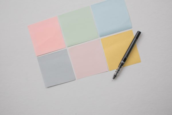 Blank colourful postit notes with pen